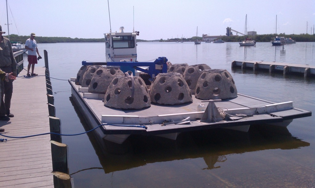 Reef Innovations Near Shore, barge with side pontoons, maneuvers into shallow water.